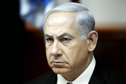 Israel's Prime Minister Benjamin Netanyahu looks on as he leads the weekly cabinet meeting in Jerusalem on April 21, 2013.  AFP PHOTO POOL GALI TIBBON