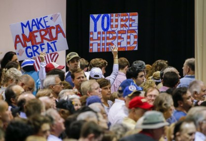 Supporters hold signs as Republican US presidential candidate Donald Trump speaks at a campaign rally in Norcross, Georgia, USA, 10 October 2015. The visit, attended by thousands, is Trump's first rally in metro Atlanta since he joined the race. (EPA/ERIK S. LESSER)